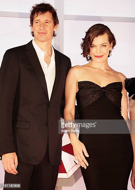 Paul W S Anderson poses for phototgraphs with Milla Jovovich speak to Japanese fans during the 'Resident Evil Retribution' World Premiere at Roppongi...