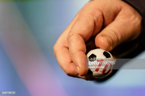 Paul Wade draws out ball during the FFA Cup round of 32 draw announcement at the FFA Offices on June 30 2016 in Sydney Australia