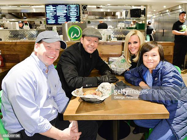 Paul Wahlberg Donnie Wahlberg Jenny McCarthy and Elijah Wahlberg enjoy a Wahlbuger at the Canadian launch of Wahlburgers Family Restaurant on...
