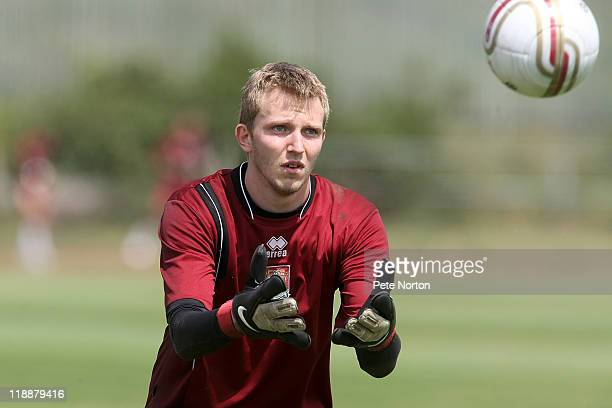 Paul Walker of Northampton Town in action during a training session at Sixfields Stadium on July 11 2011 in Northampton England Walker has signed a...