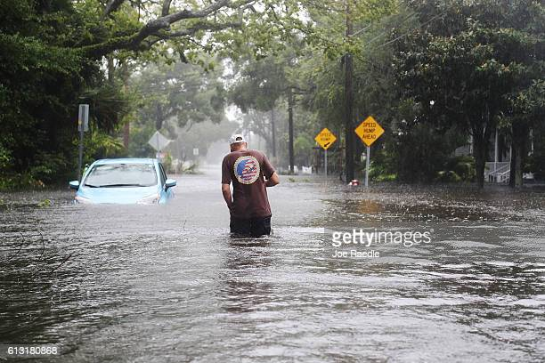Paul walks through a flooded street as Hurricane Matthew passes through the area on October 7 2016 in St Augustine Florida Florida Georgia South...