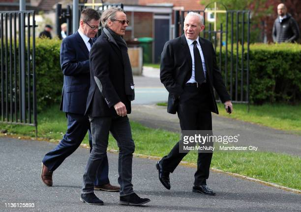 Paul Walsh and Peter Reid arrive at the Funeral of Manchester City Life President Bernard Halford at St Mary's Church in Manchester on April 10 2019...