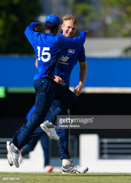 Paul Walter and Delray Rawlins of South celebrates the dismissal of Adam Hose of North during the ECB North v South Series match One at Kensington...