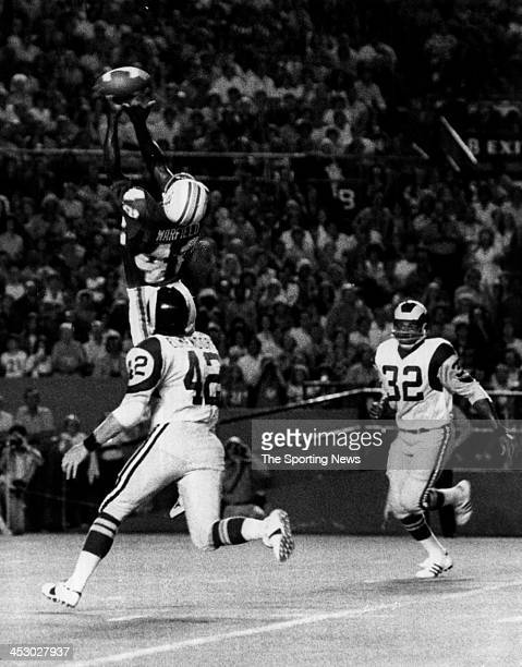 Paul Warfield of the Miami Dolphins makes a catch for 26-yards against Dave Elmendorf and Cullen Bryant of the Los Angeles Rams circa 1973 in Miami,...