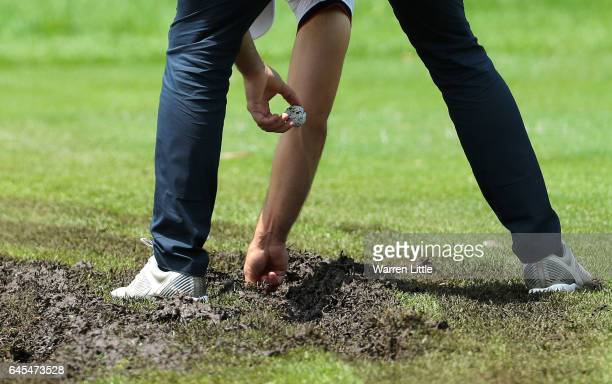 Paul Waring of England marks his ball on the 1st fairway during completion of the suspended third and final round of The Joburg Open at Royal...