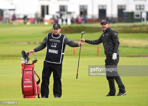 Paul Waring of England on the 17th hole with his caddie during Day three of the Alfred Dunhill Links Championship at Carnoustie Golf Links on...