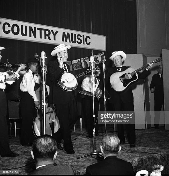 Paul Warren on fiddle Jake Tullock on bass Buck Graves on dobro Earl Scruggs on banjo and Lester Flatt on guitar of the bluegrass group Flatt And...