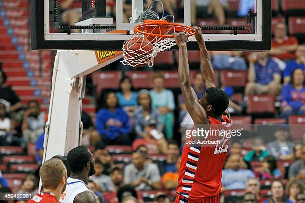 Paul Watson of the Fresno State Bulldogs dunks the ball against the Florida Gators during the MetroPCS Orange Bowl Basketball Classic on December 21...