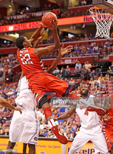 Paul Watson of the Fresno State Bulldogs shoots the ball against the Florida Gators during the MetroPCS Orange Bowl Basketball Classic on December 21...