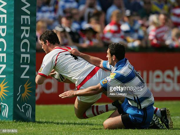 Paul Wellens of St Helens dives over the line to score a try ahead of Stephen Wild of Wigan Warriors during the Powergen Challenge Cup Quarter Final...