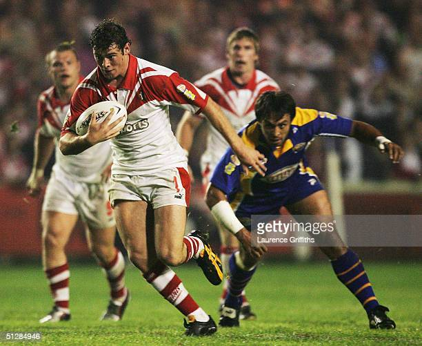 Paul Wellens of St Helens is tackled by Willie Poching of Leeds during the Tetley's Super League match between St Helens and Leeds Rhinos at Knowsley...