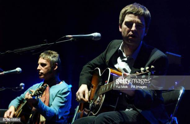 Paul Weller and Noel Gallagher perform on stage during the third in a series of special concerts for the Teenage Cancer Trust Charity at the Royal...