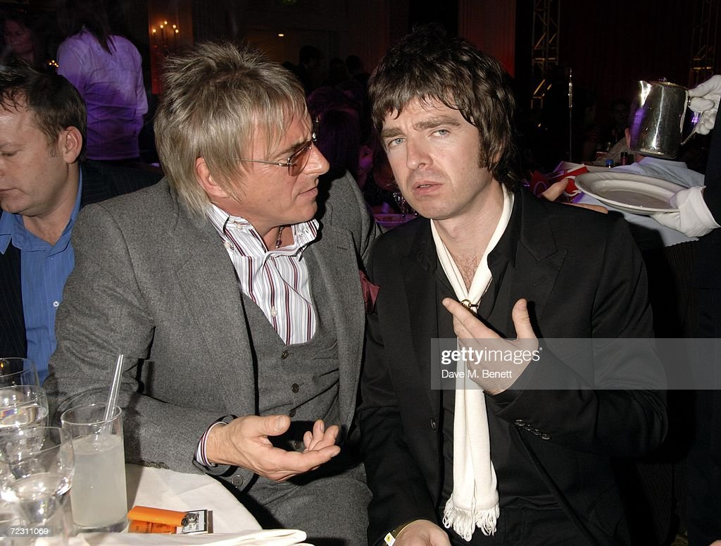 Paul Weller and Noel Gallagher pose backstage at the Q Awards 2006, the magazine's annual music awards, at Grosvenor House October 30, 2006 in London, England.