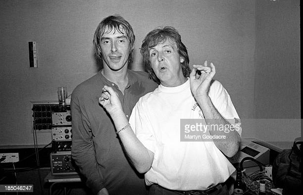 Paul Weller and Paul McCartney at Abbey Road studio during the making of the 'The Help Album' recorded for the charity War Child London United...