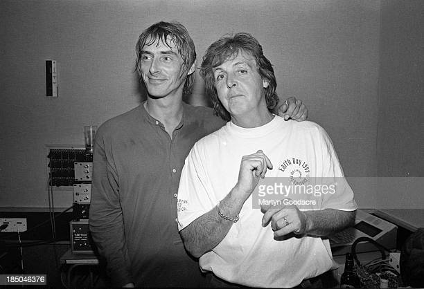Paul Weller and Paul McCartney at Abbey Road studio during the making of the 'The Help Album', recorded for the charity War Child, London, United...