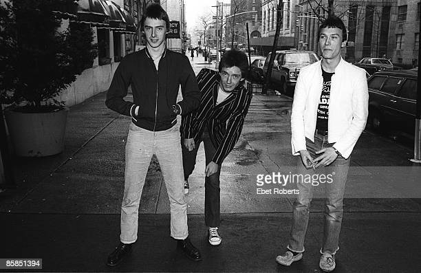 LR Paul Weller Bruce Foxton Rick Buckler of The Jam posed group shot on New York street April 1979