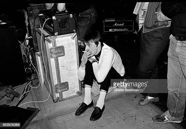 Paul Weller of The Jam sits at the back of the stage smoking before the band's farewell concert Brighton Centre Brighton United Kingdom 11th December...