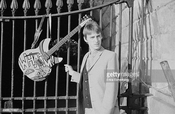 Paul Weller of the Style Council poses with his Rickenbacker guitar at the Serpentine Hyde Park London 1983