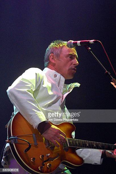 Paul Weller performing on stage at Wembley Arena in London on the 30th October 2002