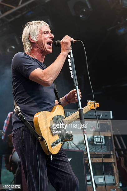 Paul Weller performs on stage at Warwick Castle on July 11 2014 in Warwick United Kingdom