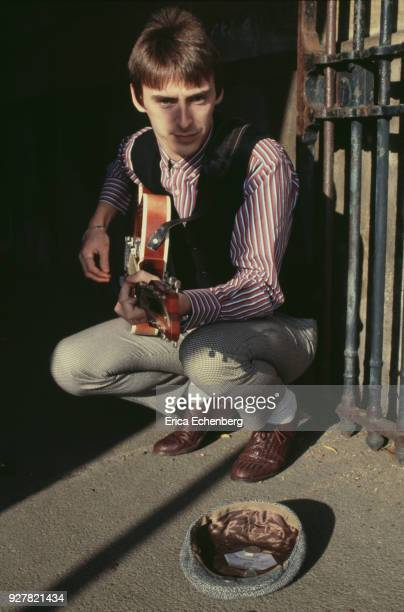 Paul Weller portrait busking with guitar at The Serpentine in Hyde Park London 1982