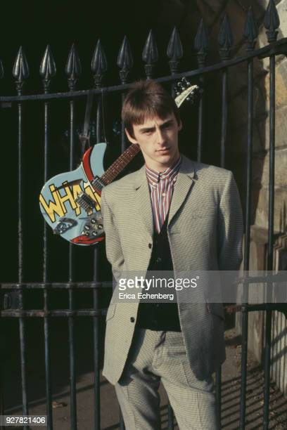 Paul Weller portrait with guitar at The Serpentine in Hyde Park London 1982
