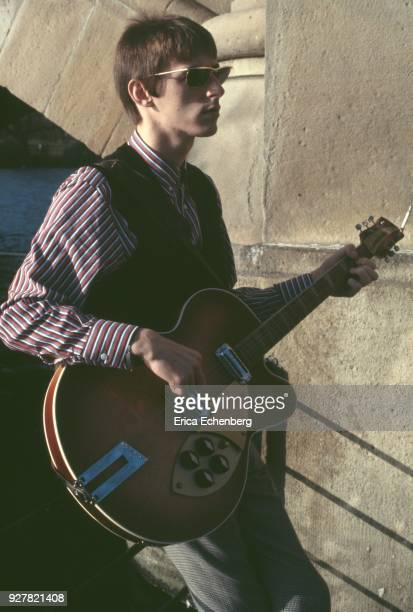 Paul Weller, portrait with guitar at The Serpentine in Hyde Park, London, 1982.
