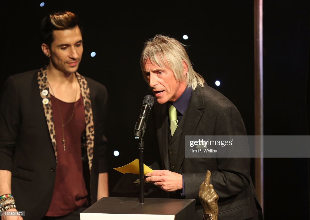 Paul Weller presents an award at the NME Awards 2013 at the Troxy on February 27, 2013 in London, England.
