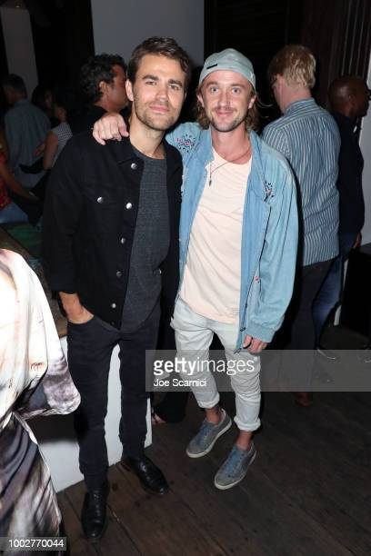 Paul Wesley and Tom Felton attend the Fandom Party during ComicCon International 2018 at Float at Hard Rock Hotel San Diego on July 19 2018 in San...