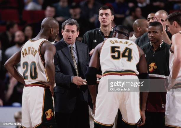 Paul Westphal, Head Coarch for the Seattle SuperSonics gives instructions to Gary Payton and Horace Grant in the huddle during the NBA Pacific...
