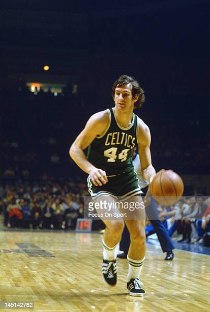 Paul Westphal of the Boston Celtics dribbles the ball up court against the Washington Bullets during an NBA basketball game circa 1975 at the Capital...