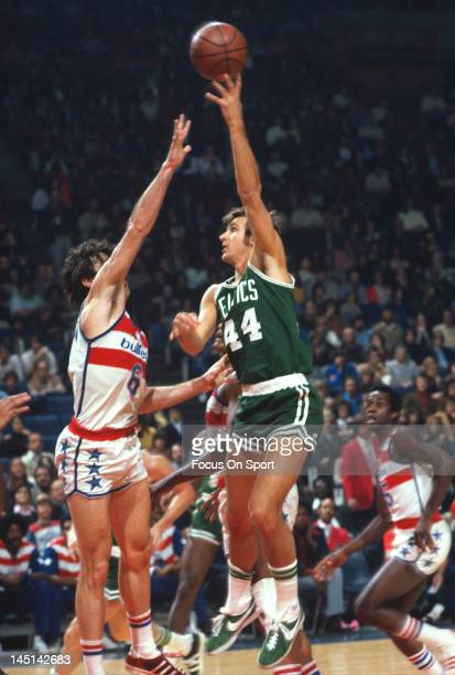 Paul Westphal of the Boston Celtics shoot over Mike Riordan of the Washington Bullets during an NBA basketball game circa 1975 at the Capital Centre...