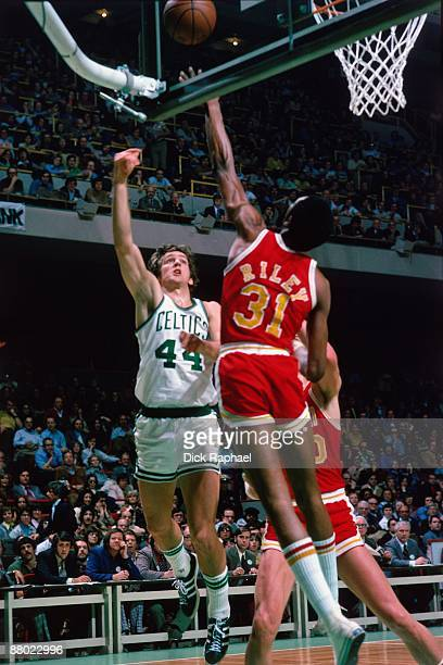 Paul Westphal of the Boston Celtics shoots a layup against Ron Riley of the Houston Rockets during a game played in 1975 at the Boston Garden in...