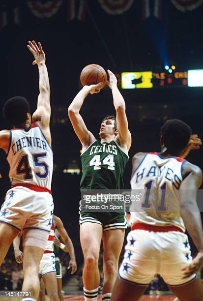 Paul Westphal of the Boston Celtics shoots over Phil Chenier of the Washington Bullets during an NBA basketball game circa 1975 at the Capital Centre...