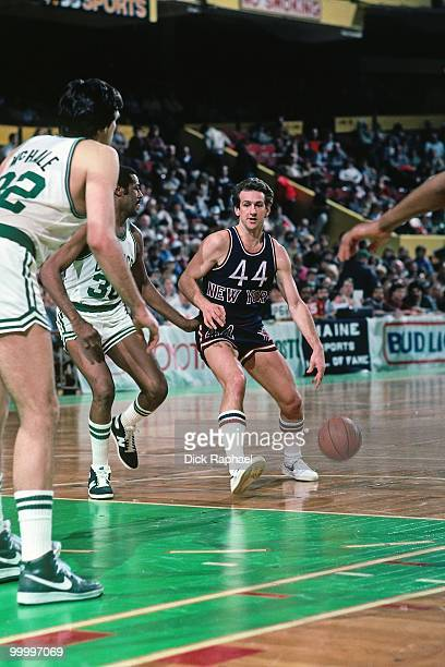 Paul Westphal of the New York Knicks drives the ball up court against the Boston Celtics during a game played in 1983 at the Boston Garden in Boston...