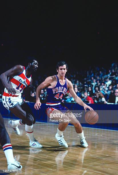Paul Westphal of the Phoenix Suns drive on Elvin Hayes of the Washington Bullets during an NBA basketball game circa 1977 at the Capital Centre in...