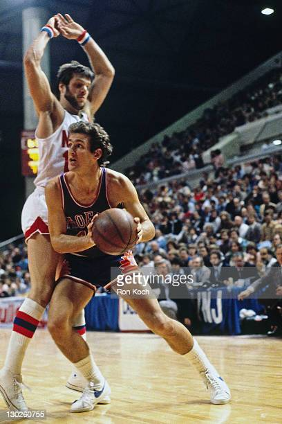 Paul Westphal of the Phoenix Suns drives against the New Jersey Nets during a game played circa 1975 at the Rutgers Athletic Center in Piscataway New...