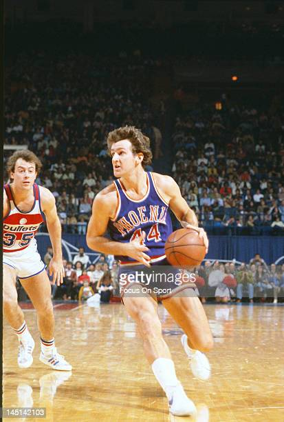 Paul Westphal of the Phoenix Suns drives past Kevin Grevey of the Washington Bullets during an NBA basketball game circa 1977 at the Capital Centre...