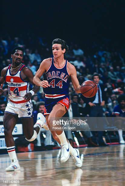 Paul Westphal of the Phoenix Suns drives past Tom Henderson of the Washington Bullets during an NBA basketball game circa 1978 at the Capital Centre...