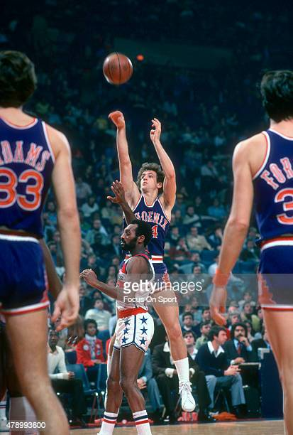Paul Westphal of the Phoenix Suns shoots over Charles Johnson of the Washington Bullets during an NBA basketball game circa 1978 at the Capital...