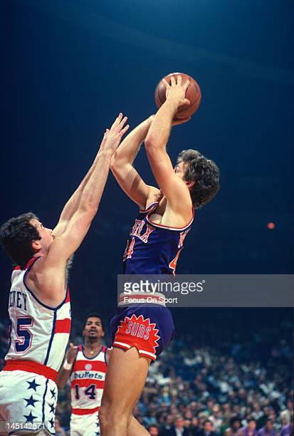 Paul Westphal of the Phoenix Suns shoots over Kevin Grevey of the Washington Bullets during an NBA basketball game circa 1978 at the Capital Centre...
