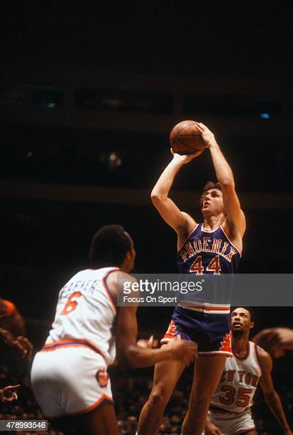 Paul Westphal of the Phoenix Suns shoots over Tom Baker of the New York Knicks during an NBA basketball game circa 1978 at Madison Square Garden in...