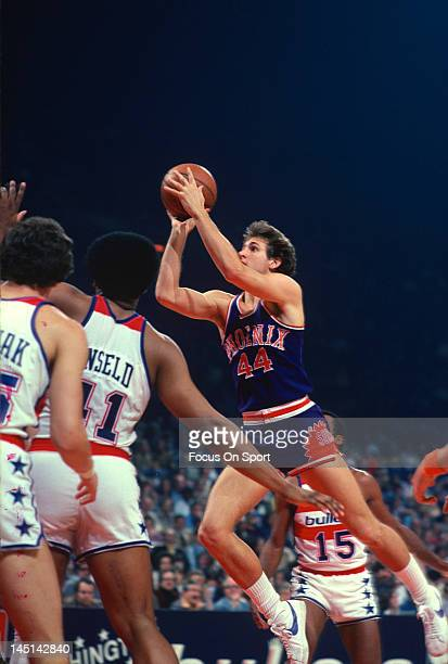 Paul Westphal of the Phoenix Suns shoots over Wes Unseld of the Washington Bullets during an NBA basketball game circa 1978 at the Capital Centre in...