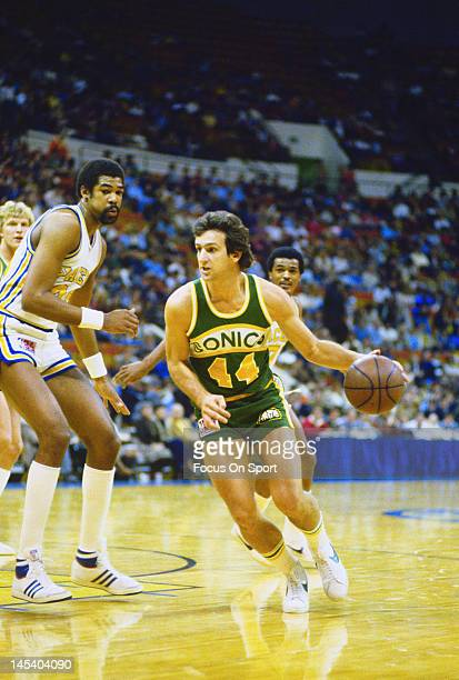 Paul Westphal of the Seattle Supersonics drives past James Edwards of the Indiana Pacers during an NBA basketball game circa 1981 at Market Square...