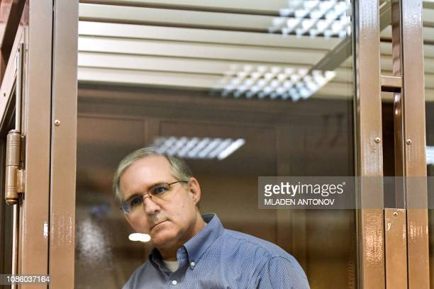 TOPSHOT Paul Whelan a former US Marine accused of espionage and arrested in Russia stands inside a defendants' cage during a hearing at a court in...