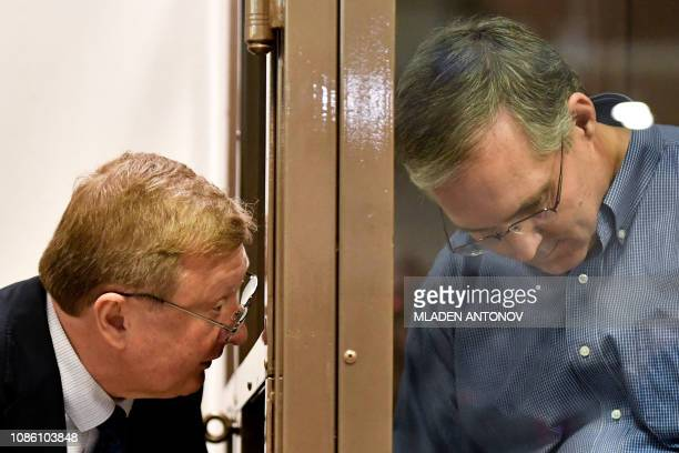 Paul Whelan a former US Marine accused of espionage and arrested in Russia listens to his lawyers while standing inside a defendants' cage during a...
