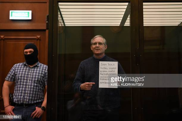 Paul Whelan a former US marine accused of espionage and arrested in Russia in December 2018 stands inside a defendants' cage as he waits to hear his...