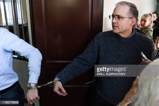 Paul Whelan a former US Marine accused of spying and arrested in Russia arrives to attend his hearing at a court in Moscow on August 23 2019