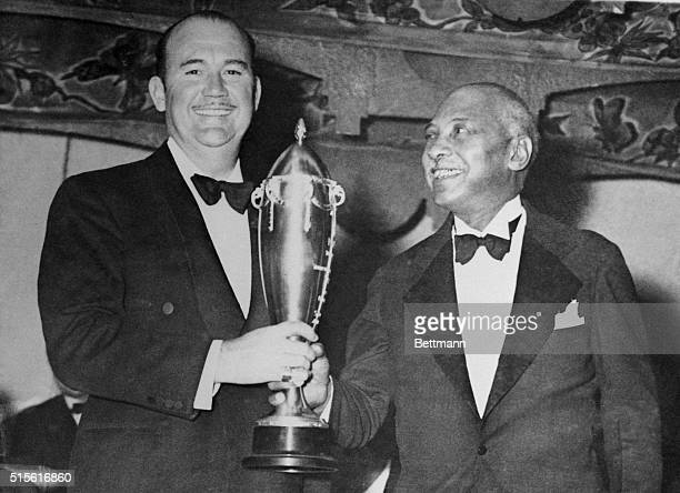 Paul Whiteman noted orchestra leader was the recipient of a handsome loving cup awarded by WC Handy noted Negro composer of the St Louis Blues in...