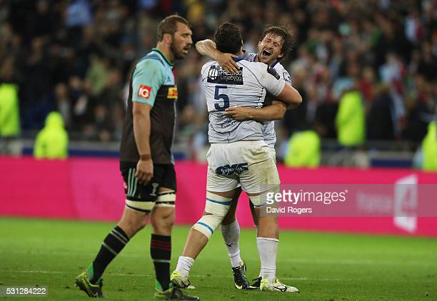 Paul Willemse and Francois Steyn of Montpellier celebrate their team's 2619 victory as a dejected Chris Robshaw of Harlequins looks on during the...